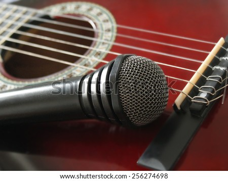 guitar and microphoneon the wooden dark background