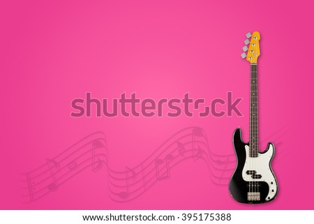 Guitar and notes on lollipop background - stock photo