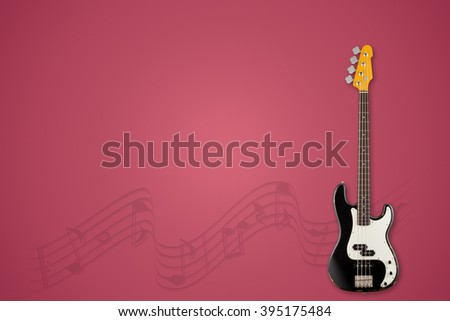 Guitar and notes on mangosteen background - stock photo