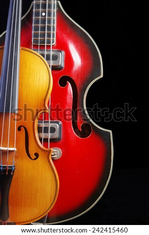 Guitar and violin on black