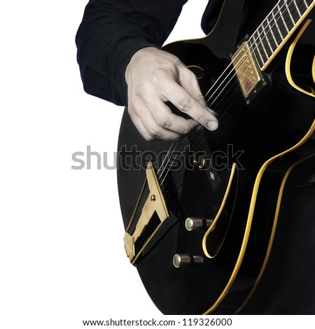 Guitar electric Guitarist playing black music instrument in hands closeup isolated on white