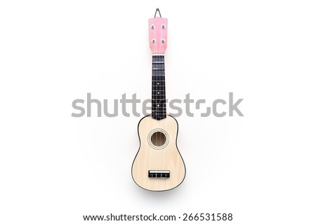Guitar hanging on white wall  - stock photo