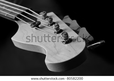 guitar head with pins closeup, black and white