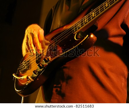 guitar in detail with hands - stock photo