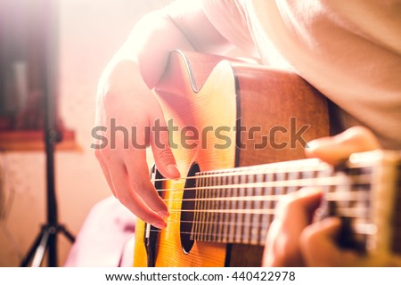 Guitar instrument. Musician or guitarist. Music, musical sound. Finger, hand on string. Acoustic concert closeup. Player play chord. Wood jazz, rock performance. Fretboard.  - stock photo