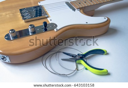 Guitar Maintenance Old Strings And An Electric Changing