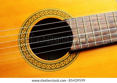 Guitar music art. Acoustic musical instrument on black