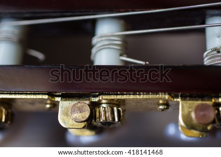 guitar neck, close-up, tune the guitar, musical instrument, fretboard, stringed musical instruments, guitar details close up, solo instrument, blues, country, flamenco, rock, metal, jazz, art      - stock photo