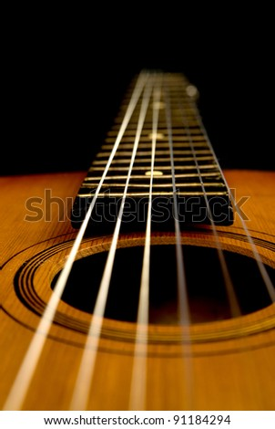 guitar on a black background - stock photo