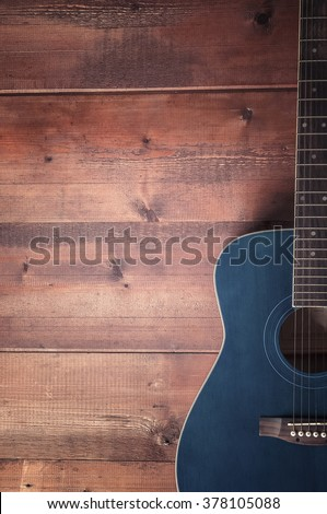 Guitar on old wood surface - stock photo