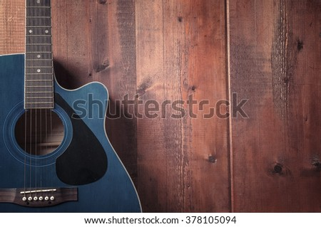 Guitar on old wood surface