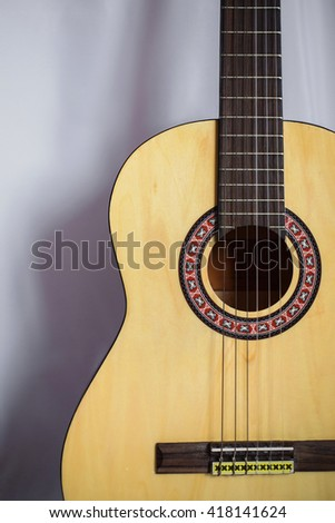 Guitar on white background, fretboard,  musical instrument, fretboard, stringed musical instruments, guitar details close up, solo instrument, blues, country, flamenco, rock, metal, jazz     - stock photo