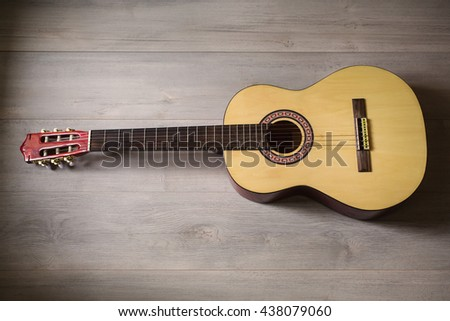 Guitar on wooden background, fretboard - stock photo