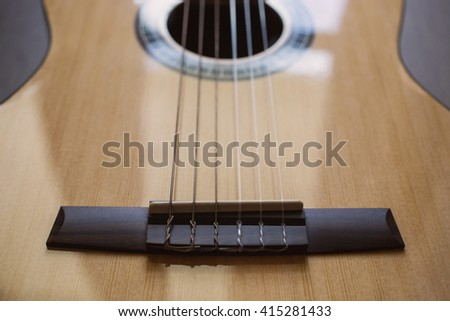 Guitar on wooden background, fretboard, stringed musical instruments, guitar details close up, solo instrument, blues, country, flamenco, rock, metal, jazz