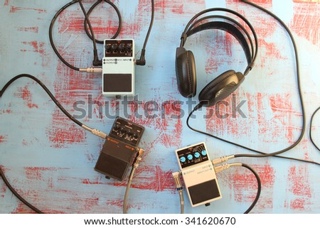 Guitar pedal and headset - stock photo