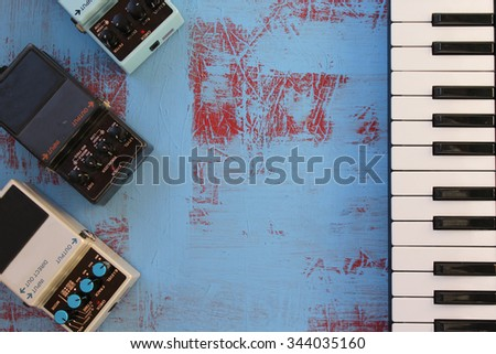 Guitar pedals and piano keys  - stock photo