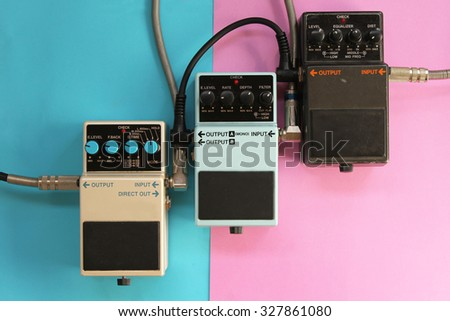 Guitar pedals on half blue half pink background - music concept - stock photo