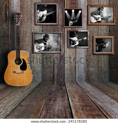 Guitar player photo in vintage wood room. - stock photo