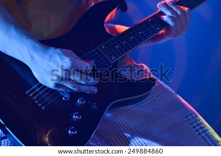 Guitar player with electric guitar  - stock photo