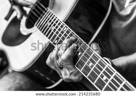 guitar playing - instruments music black and white - stock photo
