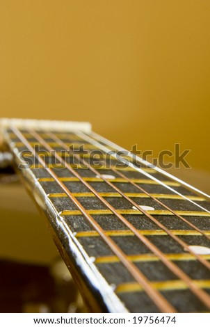 Guitar side view - string, fingerboard. Can be used as a nice background - stock photo