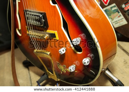 Guitar strings closeup. Music is everywhere. Rockabilly musical instrument on the stage. - stock photo