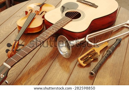 Guitar, trumpet, violin and music instruments - stock photo
