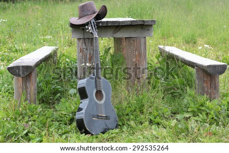 Guitar with cowboy hat - stock photo