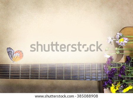 Guitar with flowers and butterfly. Dramatic color (soft focus, vintage filtered)  - stock photo