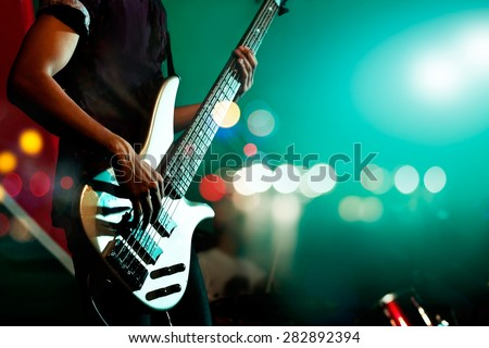Guitarist bass on stage for background, colorful, soft focus and blur - stock photo