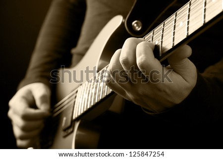 guitarist hands - stock photo