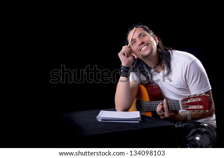 Guitarist musician writing a song on his guitar