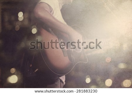 Guitarist on stage grunge background, vintage and retro color tone style, soft and blur concept - stock photo