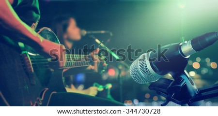 Guitarist on stage with microphone for background, soft and blur concept - stock photo