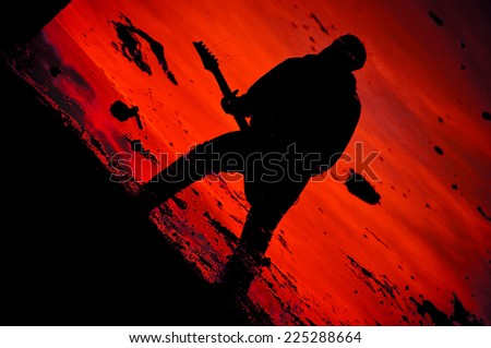 Guitarist silhouette, poster or cd layout of musician - stock photo
