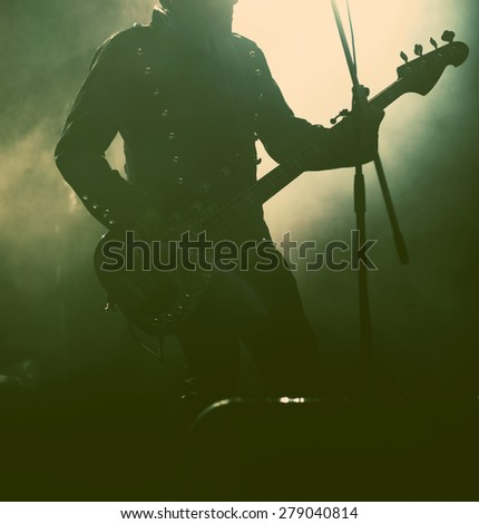 Guitarist silhouette - retro style photo - stock photo