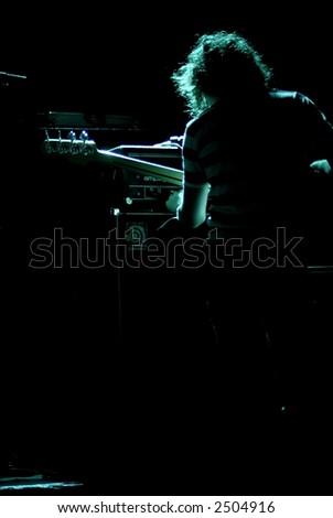 Guitarist tuning equipment for show - stock photo