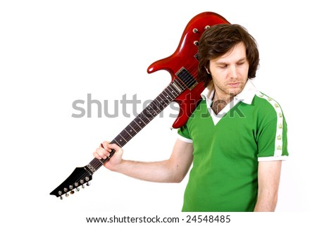 guitarist with guitar on his shoulder