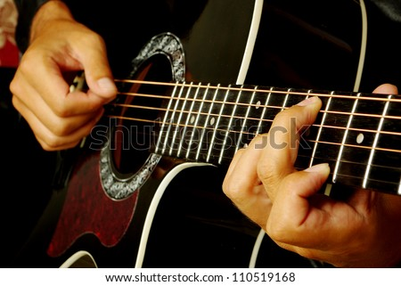 Guitarman play. Close up. - stock photo