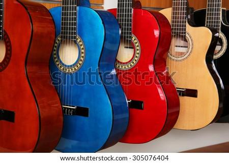 Guitars in music store - stock photo