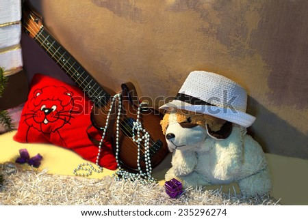 Guitars, pillow and soft dog near the shabby wall - stock photo