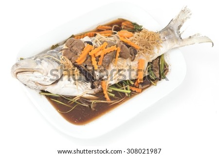 Gulao fish  in soy sauce is steamed on white plate,  Thai  food