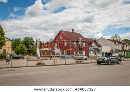 Gulbene, Latvia - Jun 13, 2016: People are walking in Gulbene city centre near the clock which is a symbol of the town