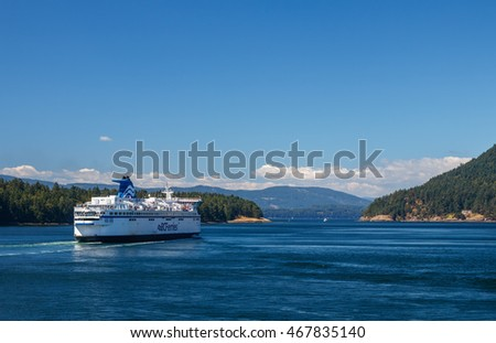 GULF ISLANDS, BRITISH COLUMBIA, CANADA - AUGUST 04, 2016:  BC Ferry passes Gulf Islands. BC Ferries provides an essential link from mainland British Columbia to the various islands.