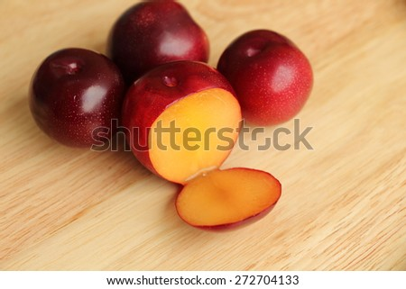 Gulf ruby plum on wood background