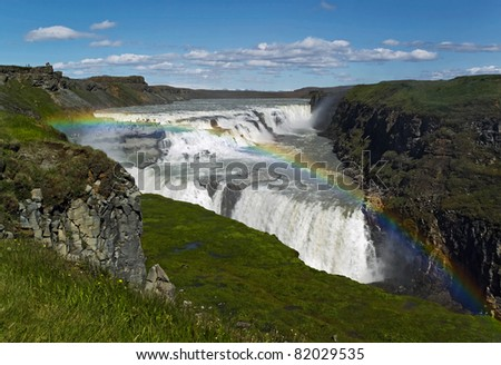 Gullfoss (Golden) falls and rainbow in Iceland - stock photo