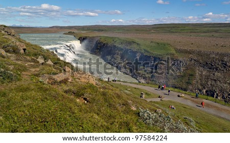 Gullfoss (Golden falls) waterfall and rainbow in Iceland - stock photo