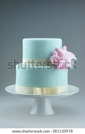 Gum paste pink roses on fondant wedding cake - stock photo