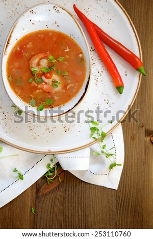 Gumbo soup on wooden background - stock photo
