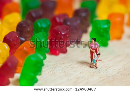 Gummi bear invasion. Harmful/ junk food concept
